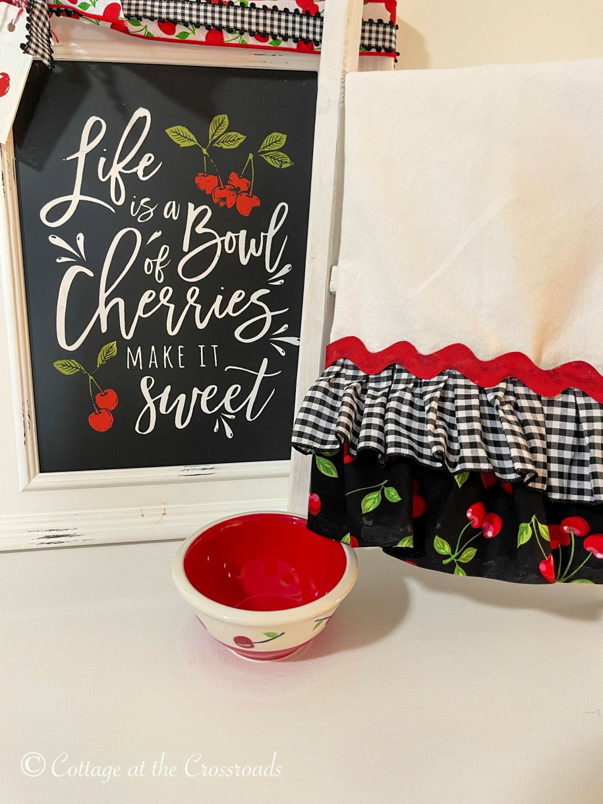 no sew ruffled tea towel beside a sign that says Life is a Bowl of Cherries